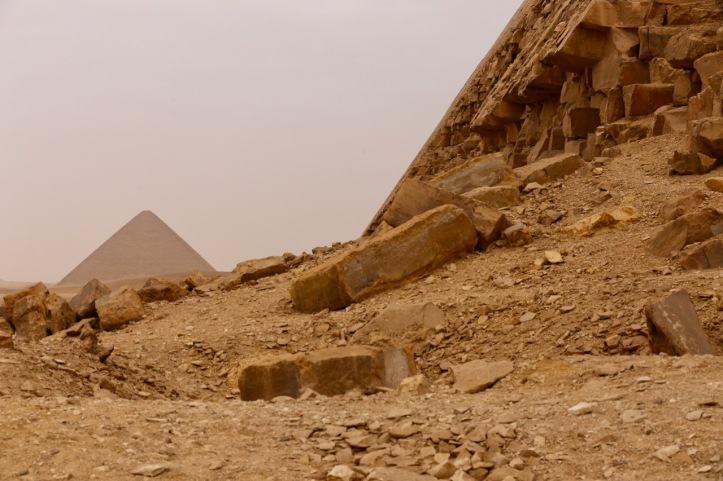 The Red pyramid in the background with a portion of the Bent Pyramid visible up close